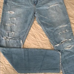 Used distressed jeans with minor paint marks